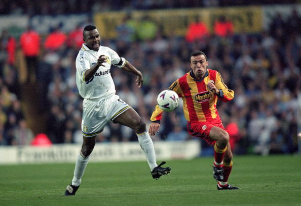 Lucas Radebe of Leeds United and Arif Erdem of Galatasaray chase the ball